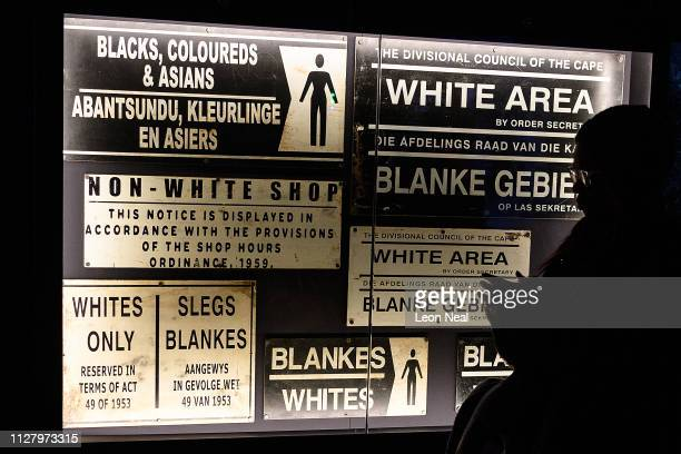 A selection of public signs from the apartheid era are in a display case at a press preview of Mandela The Official Exhibition at 26 Leake Street on...