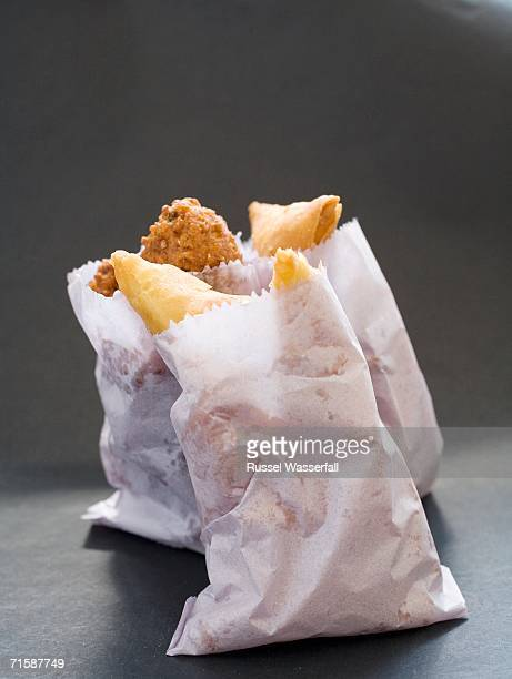 A Selection of Samosas and Chilli Bites in Paper Bags