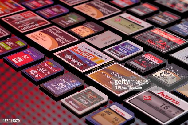A selection of SD and CF memory cards laid out and photographed under a red light taken on September 13 2012