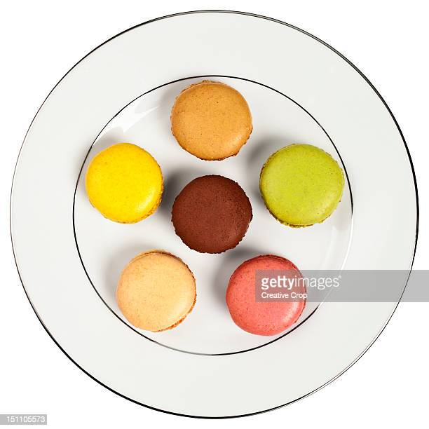 Selection of six macaroons on a white plate