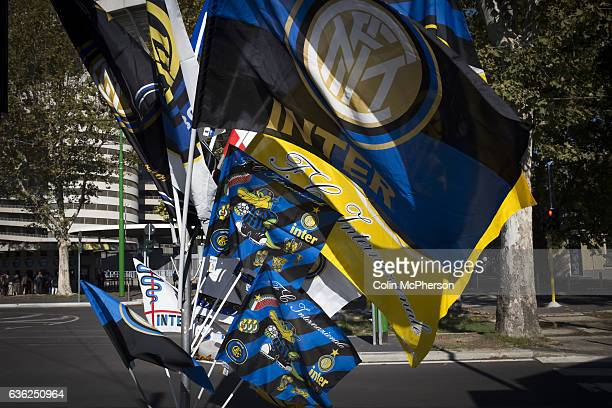 A selection of souvenir flags on sale outside the Stadio Giuseppe Meazza also known as the San Siro before Internationale took on Cagliari in an...