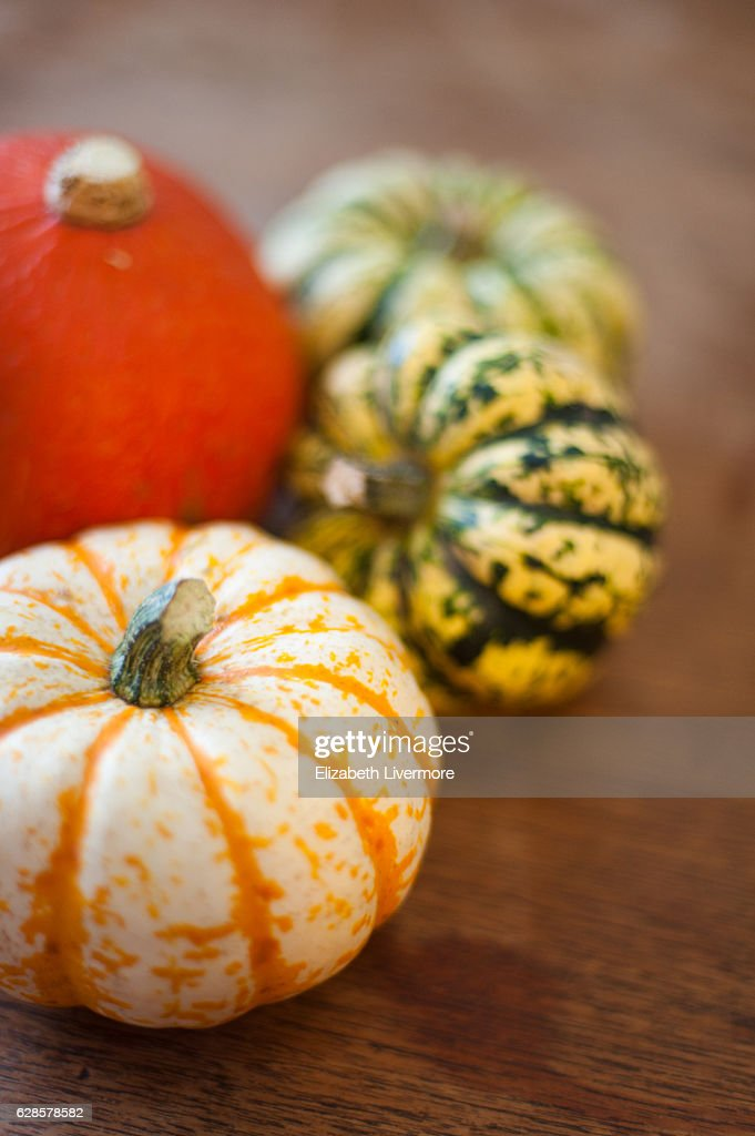 Selection of squashes on a wooden chopping board : Stock Photo