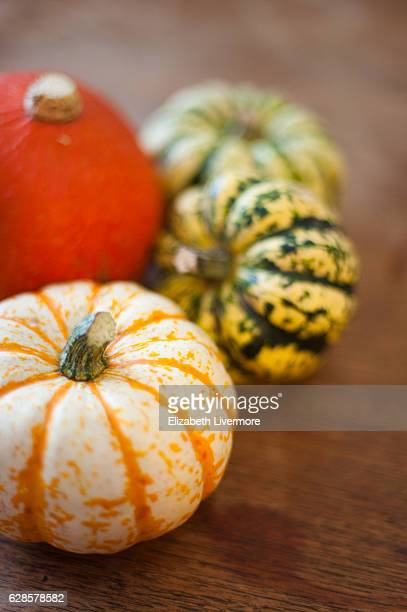 Selection of squashes on a wooden chopping board