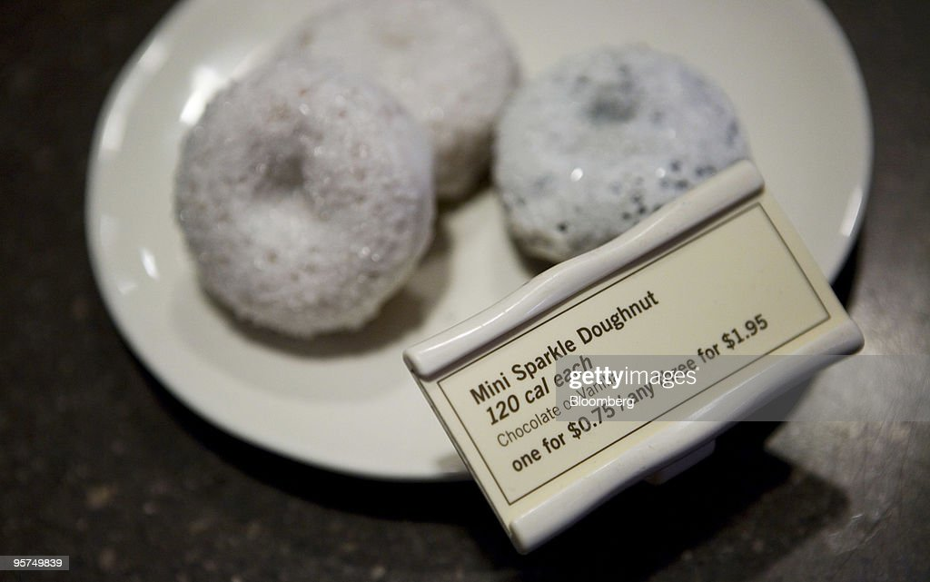 A selection of Starbucks Corp. new low calorie mini sparkle doughnuts are arranged for a photograph in New York, U.S., on Wednesday, Jan. 13, 2010. New Yorkers were more inclined to buy coffee from Starbucks Corp., especially from stores near a Dunkin' Donuts outlet, after restaurant chains were required to display calorie counts on products, researchers found. Photographer: Ramin Talaie/Bloomberg via Getty Images