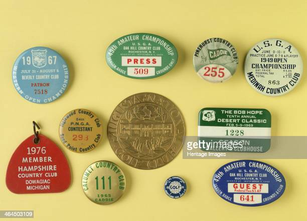 Selection of tin badges for various golfing tournaments, 1933-69; including press and guest ticket for the USGA 49th Amateur Golf Championship USGA...