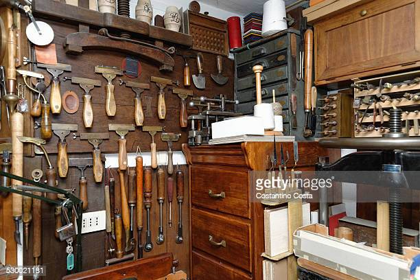 Selection of tools and equipment in traditional bookbinding workshop