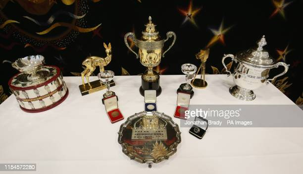 Selection of trophies, awards, and memorabilia from the tennis career of Boris Becker, including the Wimbledon singles trophy , singles runner up...