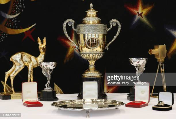 A selection of trophies awards and memorabilia from the tennis career of Boris Becker including the Wimbledon singles trophy on show in central...