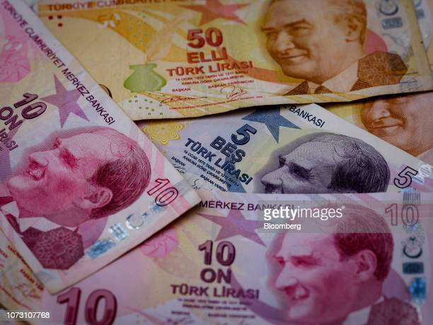 Selection of Turkish Lira banknotes sit on a table in this arranged photograph in London, U.K., on Thursday, Dec. 13, 2018. After being overtaken by...