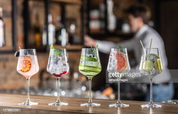 selection of various cocktails in wine glasses in a bar. - vodka stock pictures, royalty-free photos & images