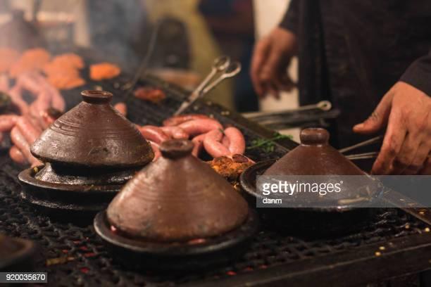 selection of very colorful moroccan tajines (traditional casserole dishes) - tajine fotografías e imágenes de stock