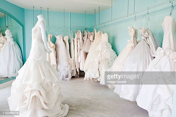 selection of wedding dresses in boutique - robe de mariée photos et images de collection