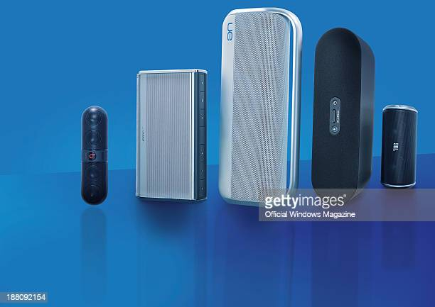 A selection of wireless speakers photographed on a blue background including Beats by Dr Dre Pill Bose SoundLink II Logitech UE Boombox Creative D80...