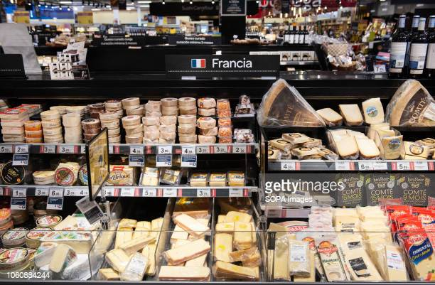A selection of worldwide cheese are displayed for sale at a Carrefour supermarket in Spain
