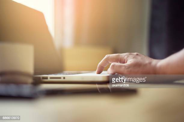 selective focus business man touching laptop computer, in cozy house  thinking about new business networking