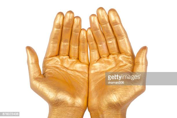selective focus golden hand pose with white background