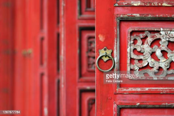 selective focus of a red door - history stock pictures, royalty-free photos & images