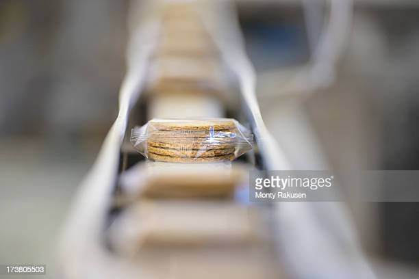 Selective focus of freshly made biscuits on production line in food factory