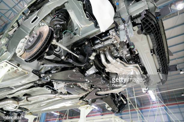selective focus shot view on commercial  chassis under cabin different pneumatic, electric equipment and various parts details. car workshop. car under inspection maintenance repair on lift. - suspension bridge stock pictures, royalty-free photos & images