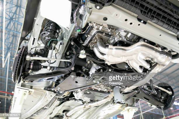 selective focus shot view on commercial  chassis under cabin different pneumatic, electric equipment and various parts details. car workshop. car under inspection maintenance repair on lift. - chassis stock pictures, royalty-free photos & images