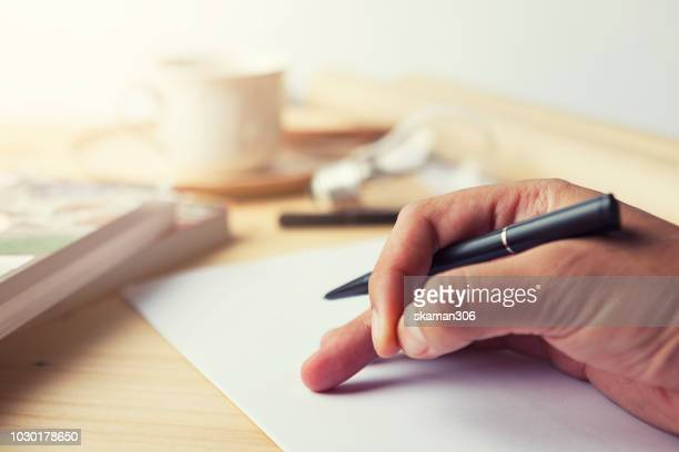 selective hand startup working with pen and paper on working space - application form stock pictures, royalty-free photos & images