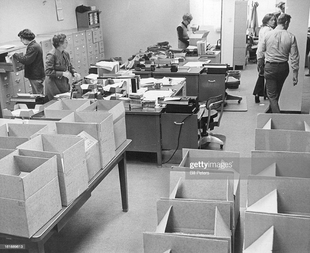 FEB 14 1976, FEB 16 1976; Selective Service Workers Pack Records To Clear Out Office; Program will e : News Photo