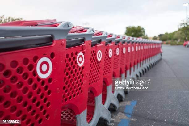 Selectivefocus image of a long row of red Target shopping cars in the parking lot of a Target department store in Dublin California May 21 2018