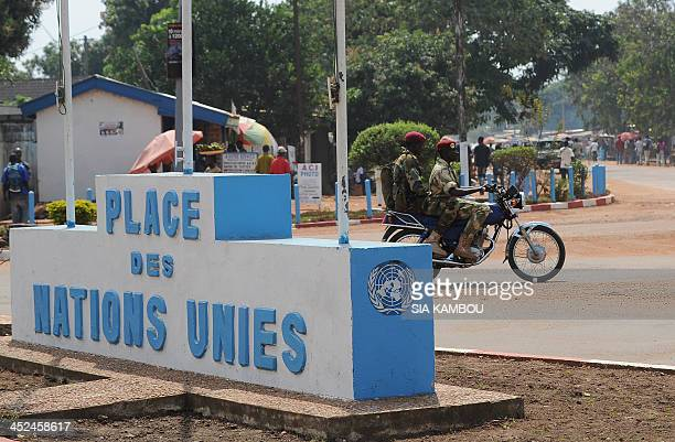 Seleka soldiers embedded in the Centrafrican army patrol in a street of Bangui on November 29 2013 The day before French troops have begun to deploy...