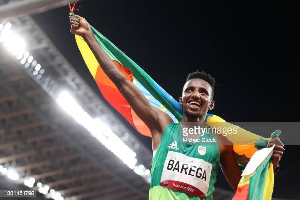 Selemon Barega of Team Ethiopia celebrates winning gold in the Men's 10,000 metres Final on day seven of the Tokyo 2020 Olympic Games at Olympic...
