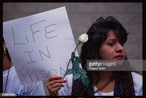 Selena fan holds a sign outside the courthouse in Houston, Texas where the slain singer's murder trail is being heard.