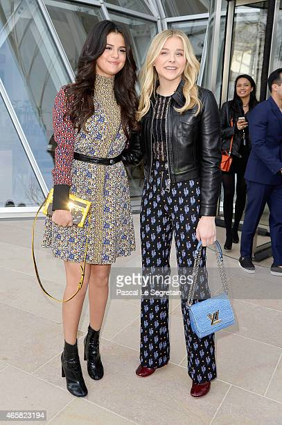 Selena Gomez and Chloe Moretz attend the Louis Vuitton show as part of the Paris Fashion Week Womenswear Fall/Winter 2015/2016 on March 11 2015 in...