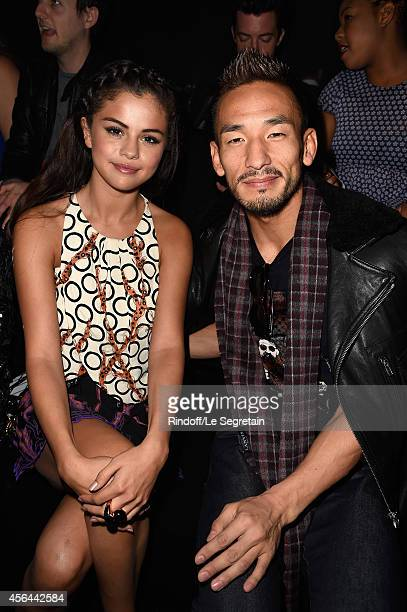 Selena Gomez and Hidetoshi Nakata attend the Louis Vuitton show as part of the Paris Fashion Week Womenswear Spring/Summer 2015 on October 1 2014 in...