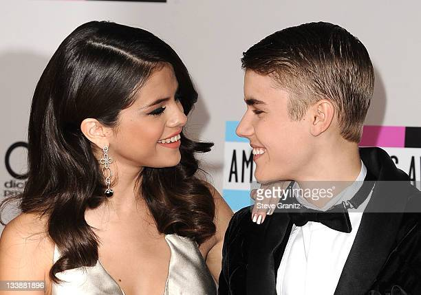 Selena Gomez and Justin Bieber arrives at the 2011 American Music Awards at Nokia Theatre LA Live on November 20 2011 in Los Angeles California