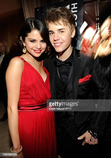Selena Gomez and Justin Bieber attend the 2011 Vanity Fair Oscar Party Hosted by Graydon Carter at the Sunset Tower Hotel on February 27 2011 in West...