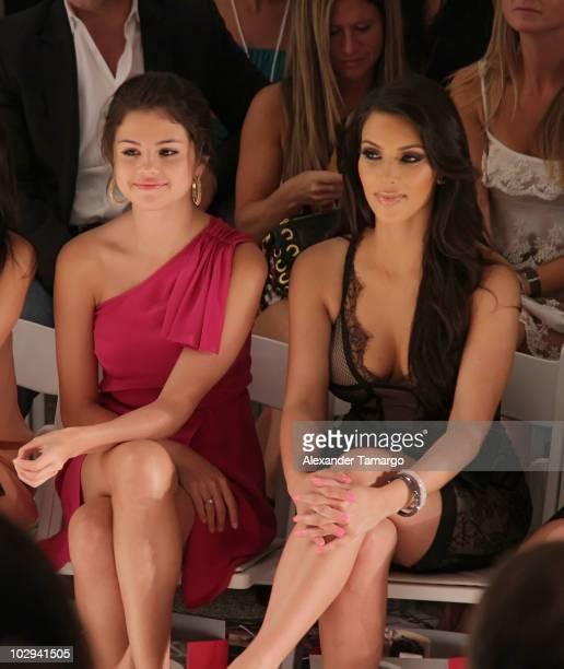 Selena Gomez and Kim Kardashian are seen sitting front row for the Beach Bunny Swimwear show during Mercedes-Benz Fashion Week Swim 2011 on July 16,...