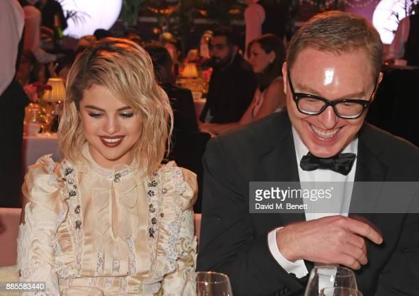 Selena Gomez and Stuart Vevers attend a drinks reception ahead of The Fashion Awards 2017 in partnership with Swarovski at Royal Albert Hall on...