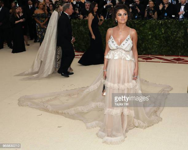 Selena Gomez attends 'Heavenly Bodies Fashion the Catholic Imagination' the 2018 Costume Institute Benefit at Metropolitan Museum of Art on May 7...