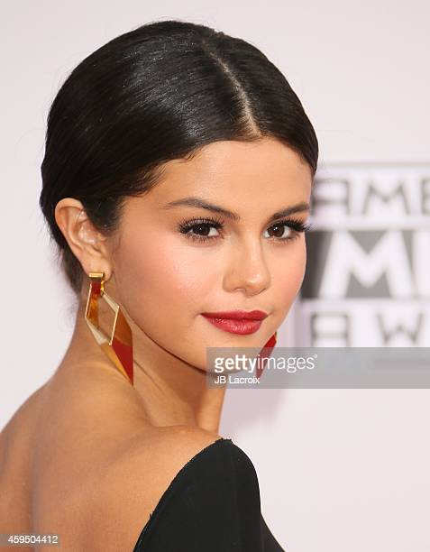 Selena Gomez attends the 2014 American Music Awards at Nokia Theatre LA Live on November 23 2014 in Los Angeles California