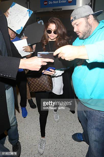 Selena Gomez is seen at LAX on March 11 2016 in Los Angeles California