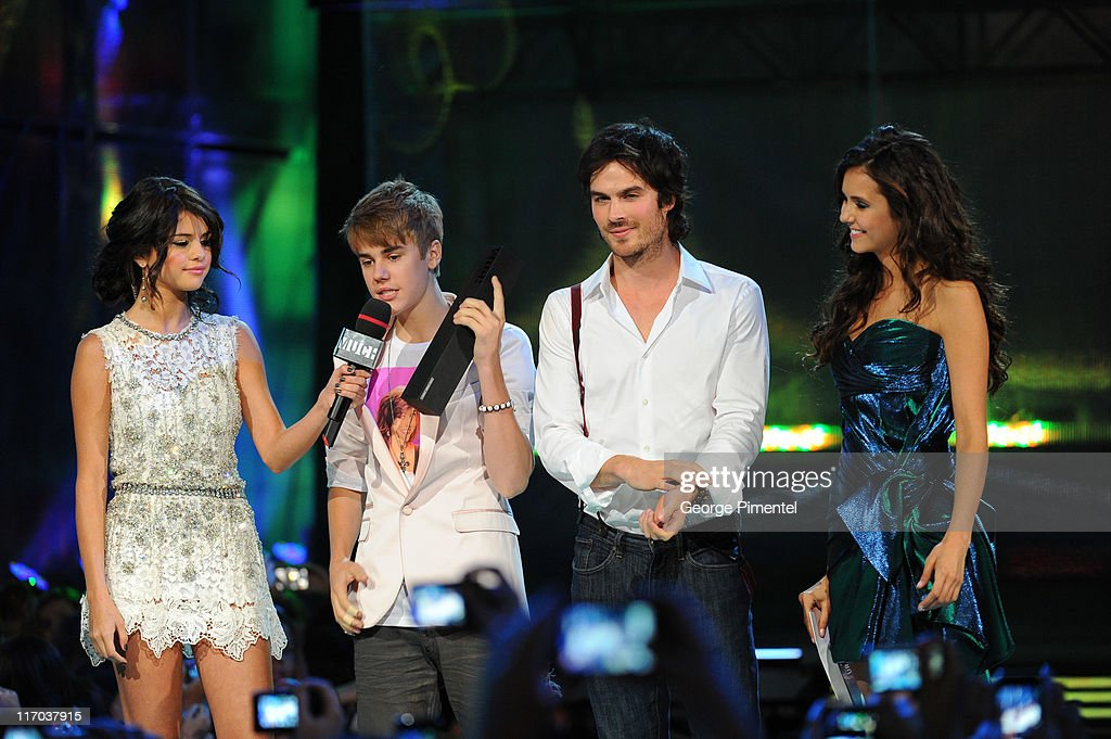 Selena Gomez, Justin Bieber, Ian Somerhalder and Nina Dobrev on stage at the 22nd Annual MuchMusic Video Awards at the MuchMusic HQ on June 19, 2011 in Toronto, Canada.