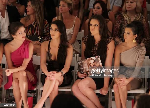 Selena Gomez, Kim Kardashian, Khloe Kardashian and Kourtney Kardashian are seen sitting front row for the Beach Bunny Swimwear show during...