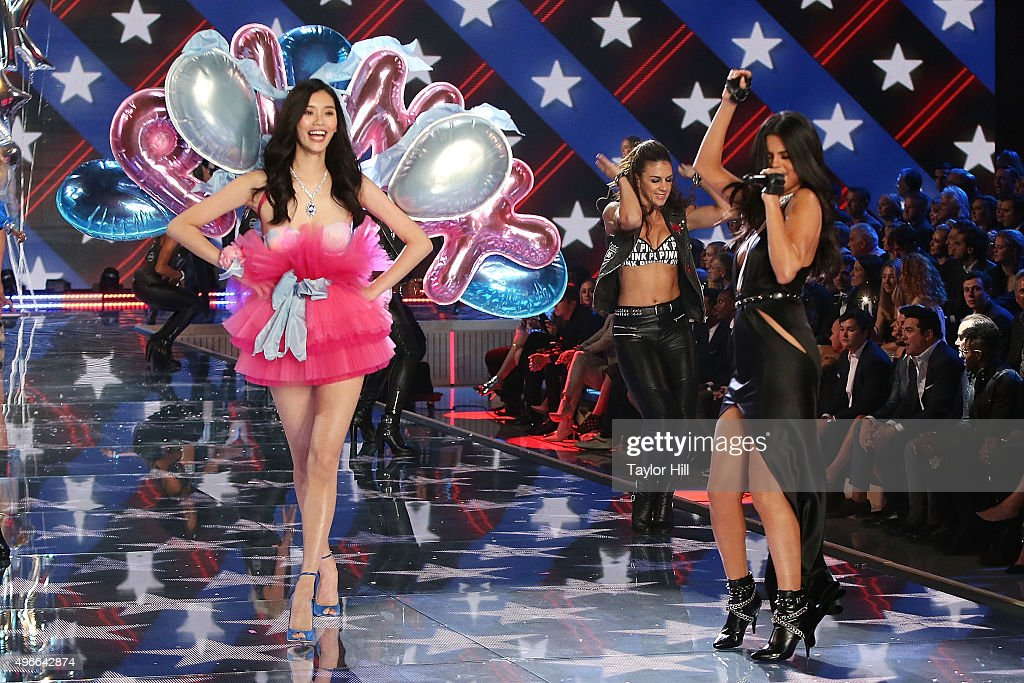 Selena Gomez performs as model Ming Xi walks the runway during the 2015 Victoria's Secret Fashion Show at Lexington Avenue Armory on November 10, 2015 in New York City.