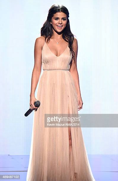 Selena Gomez performs onstage at the 2014 American Music Awards at Nokia Theatre LA Live on November 23 2014 in Los Angeles California