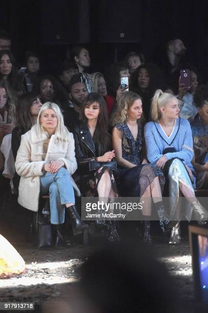 Selena Gomez Petra Collins and Carlotta Kohl attend the Coach 1941 front row during New York Fashion Week at Basketball City on February 13 2018 in...