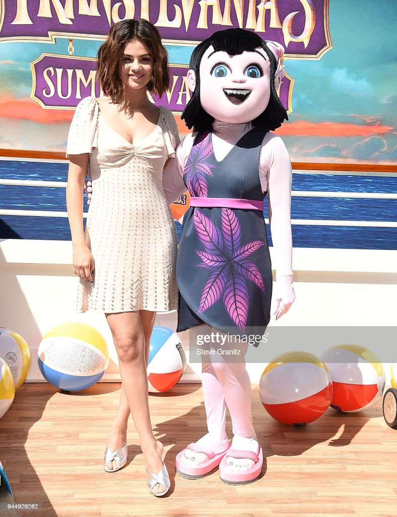 Selena Gomez poses at the Photo Call For Sony Pictures' 'Hotel Transylvania 3: Summer Vacation' at Sony Pictures Studios on April 11, 2018 in Culver City, California.