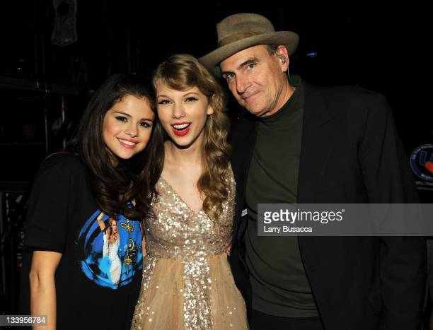 Selena Gomez Taylor Swift and James Taylor pose during the Speak Now World Tour at Madison Square Garden on November 22 2011 in New York City Taylor...