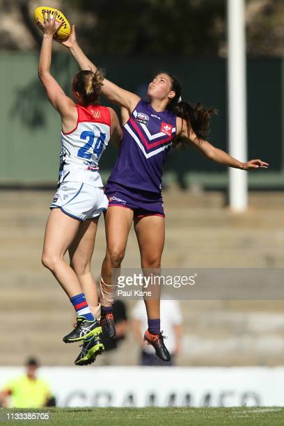 Selena Karlson of the Bulldogs and Parris Laurie of the Dockers contest the ruck during the round five AFLW match between the Fremantle Dockers and...