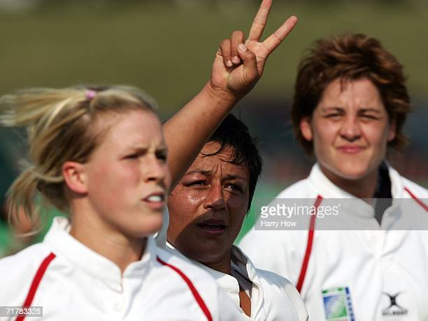 Selena Rudge of England reacts after scoring a try with teammates Charlotte Barras and Shelley Rae against South Africa during the Women's Rugby...