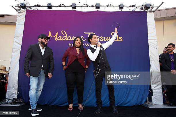 Selena's brother A.B. Quintanilla, sister Suzette Quintanilla, and husband Chris Perez greet fans awaiting the curtain drop onstage during Madame...
