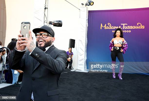 Selena's brother AB Quintanilla takes a photo after the curtain drop during Madame Tussauds Hollywood's unveiling of GRAMMY award winner and cultural...